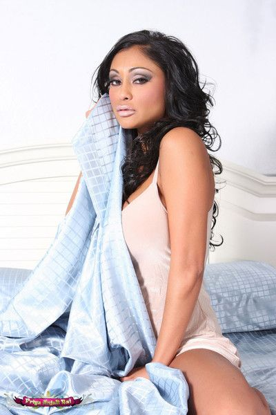 Priya rai looks stunning lounging with regard to bed and getting naked
