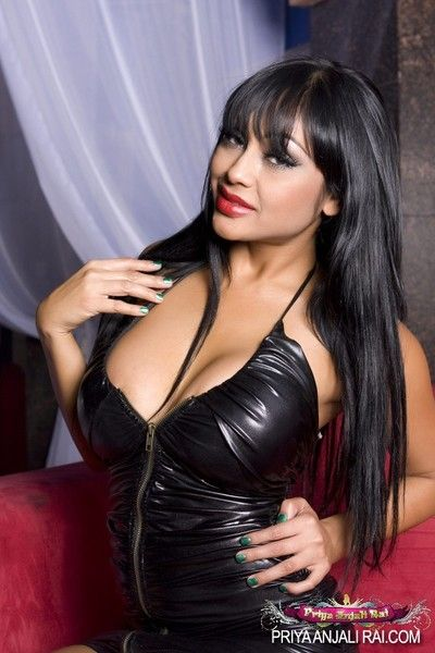 Priya Anjali Rai in the matter of her black fur zip in the matter of rags exposes her telling tits added to red hot..