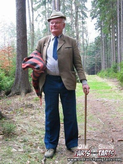 Teenage girlie reanimates a horny grandfather helter-skelter a forest