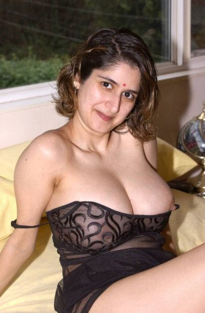 Busty dumb indian amature strips coupled with spreads legs