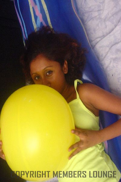 Lovely indian girl plays on touching balloons
