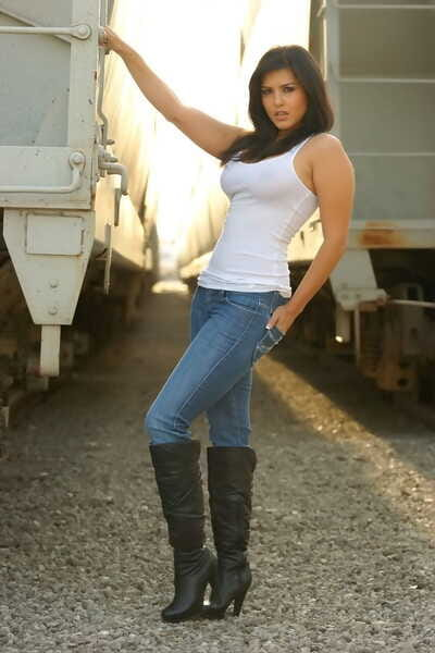 Black-haired bombshell Sunny Leone in sallow shirts- erotic jeans- plus high boots
